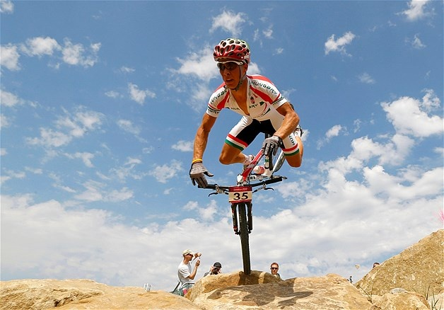 A rider falls during a cross-country mountain bike event during the London 2012 Olympic Games