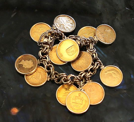 13 rare gold coins attached to a 14k gold bracelet like charms #unbranded #charmBracelet