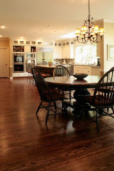 picture of the kitchen with white cabinets and dura seal coffee brown stain on red oak flooring
