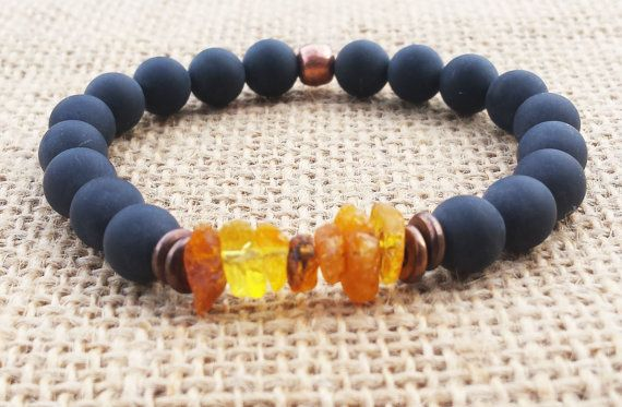 Check out this item in my Etsy shop https://www.etsy.com/uk/listing/280142998/raw-baltic-amber-bracelet-matte-black