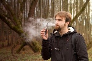 cool man with electronic cigarette