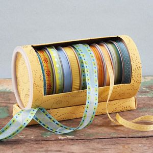 Old Oatmeal Container turned into ribbon holder. Smart! and adorable.