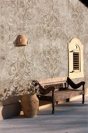 Very cool - glazes on wall, with a slightly darker stencil design