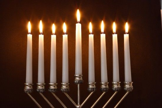 A Hanukiah has 9 candles, one of which is at a different height than the others. (But almost everyone calls them Menorahs, but strictly speaking, they are different things.)