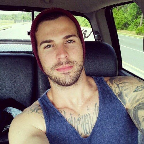 Everything about him is sexy. Lips, scruff, and tattoos. Can you say, YUMMY?!