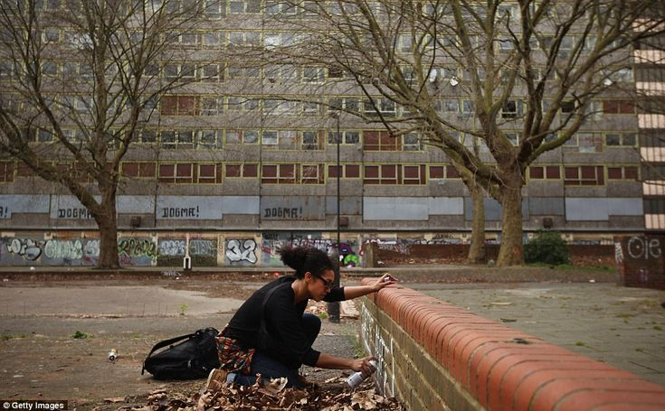 Spraying: A girl paints a wall in the Heygate estate. It has become a haven for guerrilla gardeners, storytellers and street artists