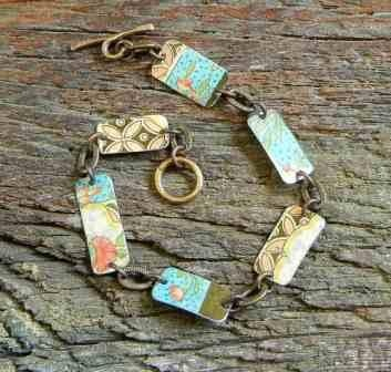 Handmade jewelry using vintage tin containers.