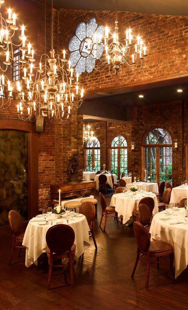 Inside this elegant landmark building—it was once Aaron Burr's carriage house—brick walls, gold chandeliers, huge bouquets of flowers, and plush seating set the scene for one the city's most popular spots for proposals. Tables near one of the restaurant's two fireplaces in the Constitution Room, or near the French windows that overlook the garden, are particularly popular with couples. Many of the cocktails nod to the restaurant's historic past like Hamilton's Way–scotch, Amaro, and ginger…
