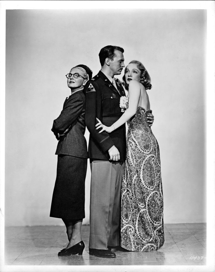 """""""A Foreign Affair"""" film still (1948), © Paramount Pictures. Courtesy of the Margaret Herrick Library, Academy of Motion Picture Arts and Sciences.  Shown from left: Jean Arthur, John Lund, Marlene Dietrich."""