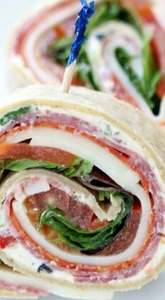 Italian Sub Sandwich Roll-Ups - these are SO delicious! Great party appetizer recipe. More