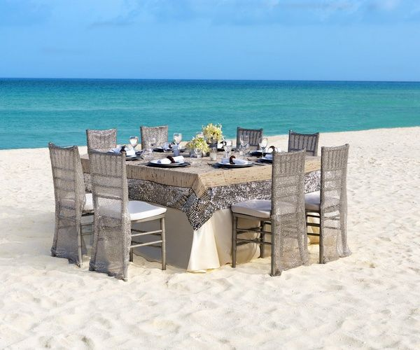 Neutral glam table setting for outdoor beach wedding reception | Metallic Sands Collection at Palace Resorts #destinationwedding