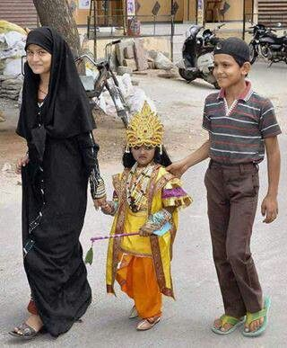 A muslim women takes her child,as like KRISHNA(Hindu)to a goes as u like competition.INDIA