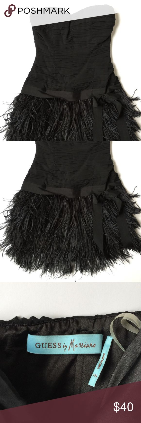 Guess by Marciano Feathered LBD Fun and flirty strapless LBD from Guess by Marciano. Flattering ruching around the top with a feathered skirt. Guess by Marciano Dresses Strapless