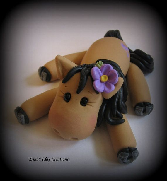 Polymer Clay Horse with Flower by trinasclaycreations on Etsy, $30.00 What a cute pony...