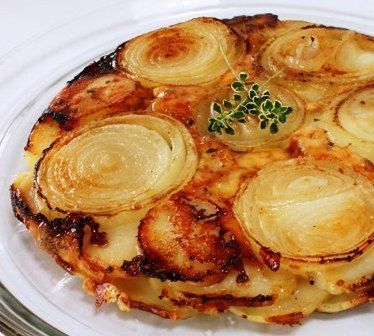 Upside Down Potato Onion...layers of onion and potato slices tossed with thyme and butter and a combo of Gruyere and mozzarella cheeses