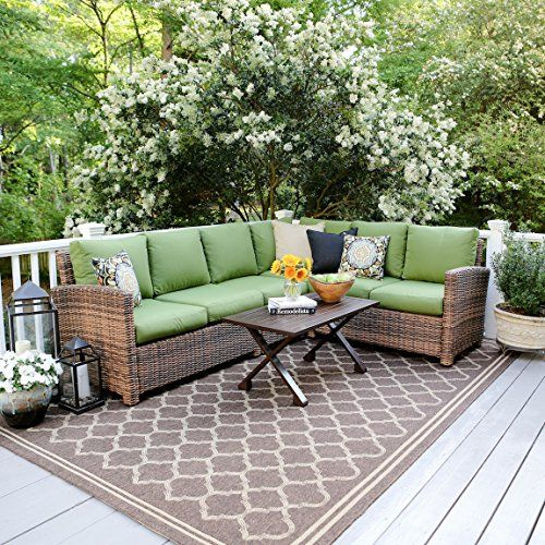 The Hand Woven Outdoor Wicker Is Modeled In Light And Dark Brown Tones  Lending A .