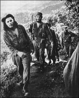 "The majority of the 82 revolutionaries that came to Cuba on the 60-foot yacht named ""Granma"" were killed or captured, but a few escaped to the Sierra Maestra, including the Castro brothers, Fidel and Raul, Che Guevara, Camilo Cienfuegos and a handful of others.  Photo shows Fidel Castro (2nd from left) and Cuban Rebels in the Sierra Maestra Mountains."