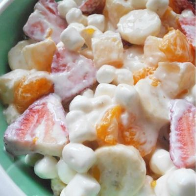 Marshmallow Fruit Salad Recipe.  Less costly made at home than purchasing at the store deli by the pound.  The choice is made depending on the budget and amount of people/guests, the time you may or not have at hand, but I have made it at home for less. Sub Kiwi or another fruit for the oranges/mandarin, whatever you like or what is on sale, fresh and natural, great summer/fourth of July dessert.