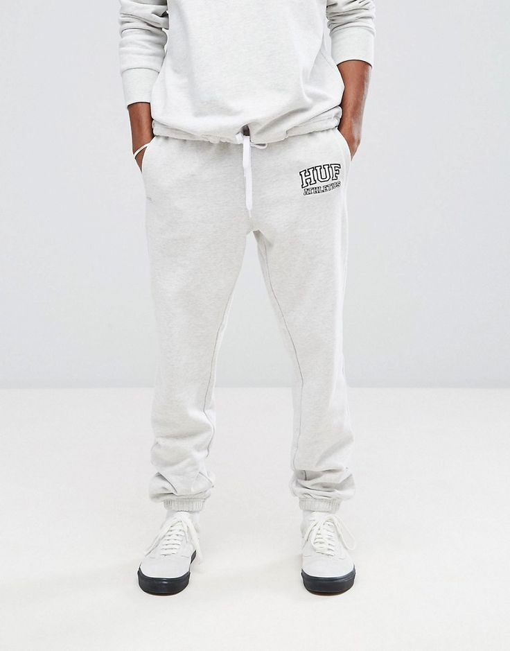Get this Huf's joggers now! Click for more details. Worldwide shipping. HUF Romes Joggers With Athletics Logo - Grey: Joggers by HUF, Soft-touch sweat fabric, Elasticated waistband, Side pockets, HUF Athletics logo, Fitted cuffs, Straight fit - cut with a straight leg. HUF owner Keith Hufnagel grew up skateboarding in the streets of New York before moving to San Francisco to pursue his passion. Opening his first store in 2002, HUF aims to bring together streetwear, footwear and…