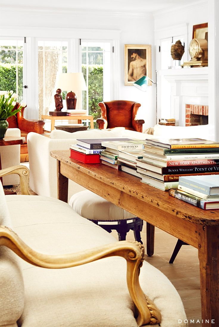 Living room filled with books and classic artwork