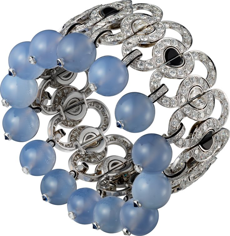 CARTIER. Bracelet - Platinum, blue chalcedony beads, faceted sapphires, onyx, black lacquer, baguette-cut diamonds, brilliant-cut diamonds. #Cartier #CartierMagicien #HauteJoaillerie #FineJewelry #Diamond #BlueChalcedony #Sapphire #Onyx