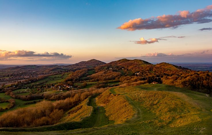 https://flic.kr/p/Ftys3d | Evening on Hereford Beacon | A beautiful clear evening on Hereford Beacon provided an opportunity to catch the setting sun shining its golden light on the ridge of the Malvern Hills.  For those of you who are not from round here, the embankments are are part of an Iron Age hill fort that covers the top part of the beacon, the hill fort being known as British Camp.  Whilst I was taking this there was an unfolding drama just out of shot, a little Terrier had got…