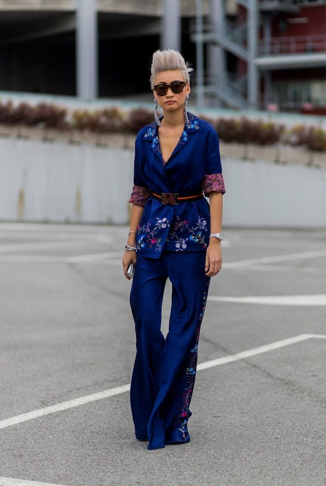 Esther Quek posing in a unique kimono-like pant suit. Elegant and light. Like the style? Start a conversation at http://www.hashch.at/