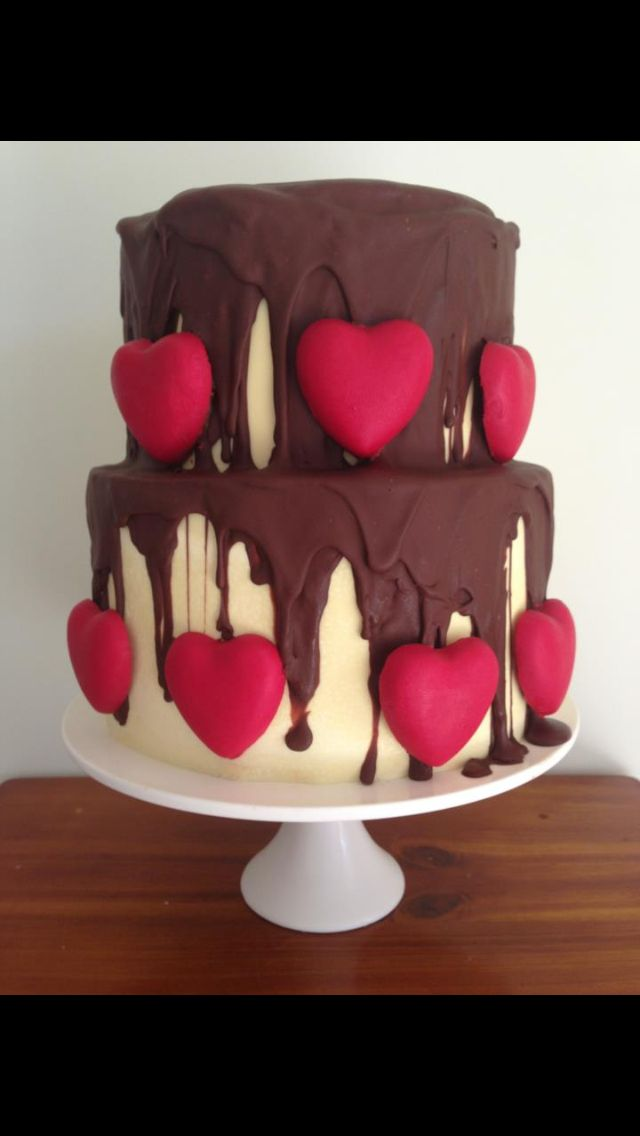 Chocolate love heart wedding or engagement cake. White chocolate collars, drizzling milk chocolate & red coloured, white chocolate love hearts.