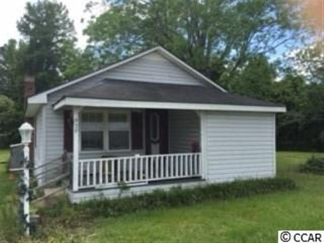 Home is being sold as is. This 3BR2BA home is outside of Loris city limits and regulations. Only county taxes to pay no city taxes. Home is across the street from Loris Middle school which is an evacuation site in case of storms. Loris High school is just around the corner as well. Close to downtown area and park. Twenty minuets from the ocean ten minuets from Lake Tabor and the Waccamaw River. Hospital is just 5 minuets away as well as a small plane airport.  Square footage is approximate…
