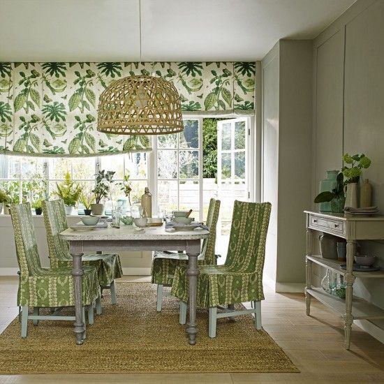 Fresh green dining room with botanical print fabrics