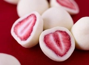 Satisfy your sweet tooth with this frozen treat: strawberries in yogurt.