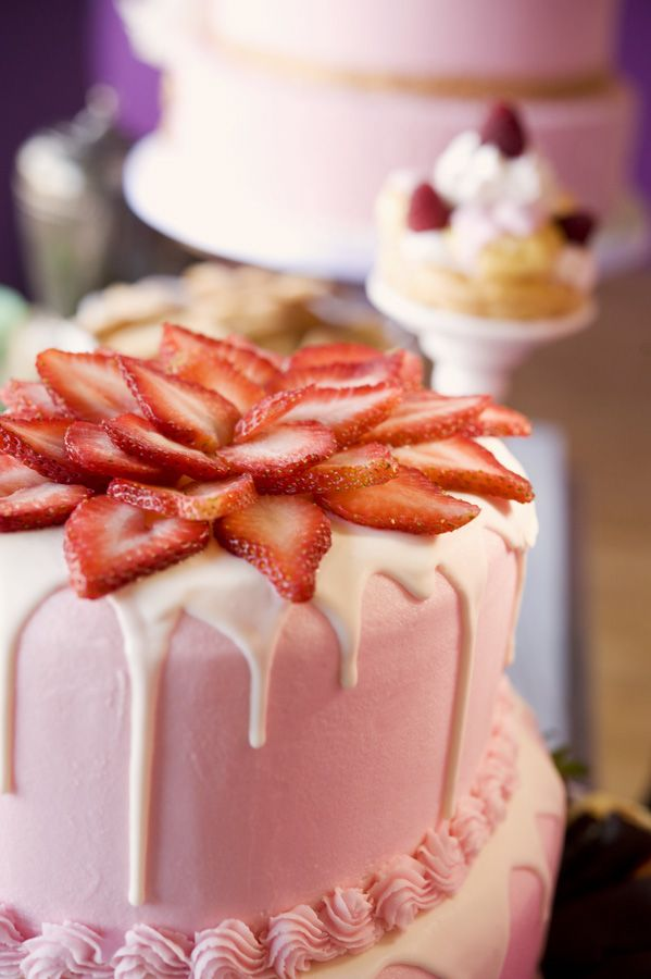 beautiful fresh strawberry 'flower' on top... yummy cake with a little healthy thrown in. ;)