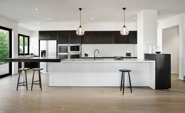 Arden Homes Kitchen featuring Calacatta Nuvo surfaces with black accents and a black tap