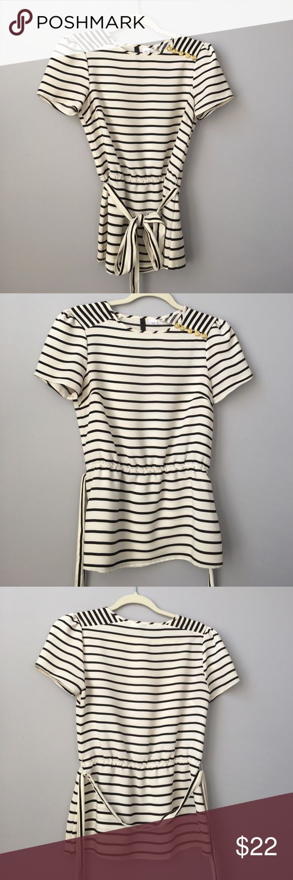 H&M black and white short sleeve blouse H&M short sleeve blouse, black and white stripped. Has elastic waists with belt, belt is detachable. Has gold buttons on left shoulder so you can easily slip over head. Size 4, but runs a little small. Worn a few times. H&M Tops Blouses