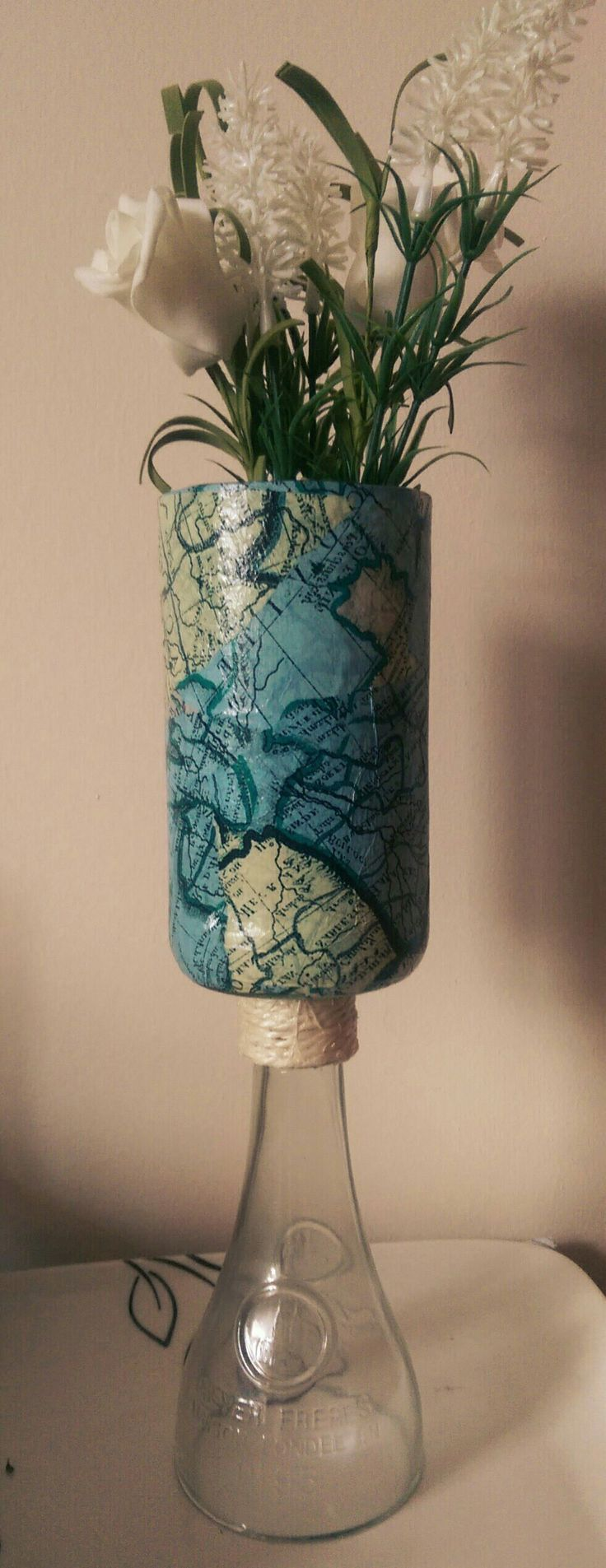Aldi lemonade bottle cut and decoupaged with olde world maps. Decorated with cord and used as a vase. Can also be used as a tealight holder!