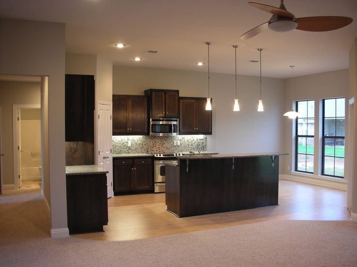 Modern Kitchen Design Features Rich Dark Wood, Small And Simple.