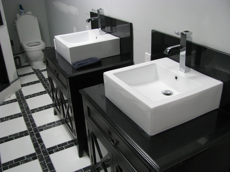 Art Exhibition Vanity tops in Nero Assoluto Granite with rectangular top mount sinks This is a linear