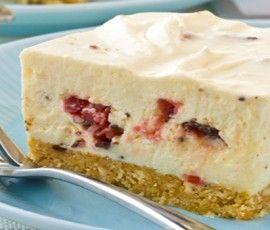 Cherry Choc Cheesecake Slice: Another NESTLÉ Sweetened Condensed Milk recipe from our 100 years of Sweet Baking Memories Book. A deliciously creamy cheesecake flavoured with coconut and chocolate cherry bars - so rich and tasty!.