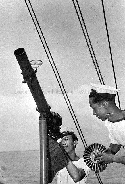 Two Malay sailors of the Malayan Royal Navy Volunteer Reserve (MRNVR) training with a lewis gun. Malaya, 1941