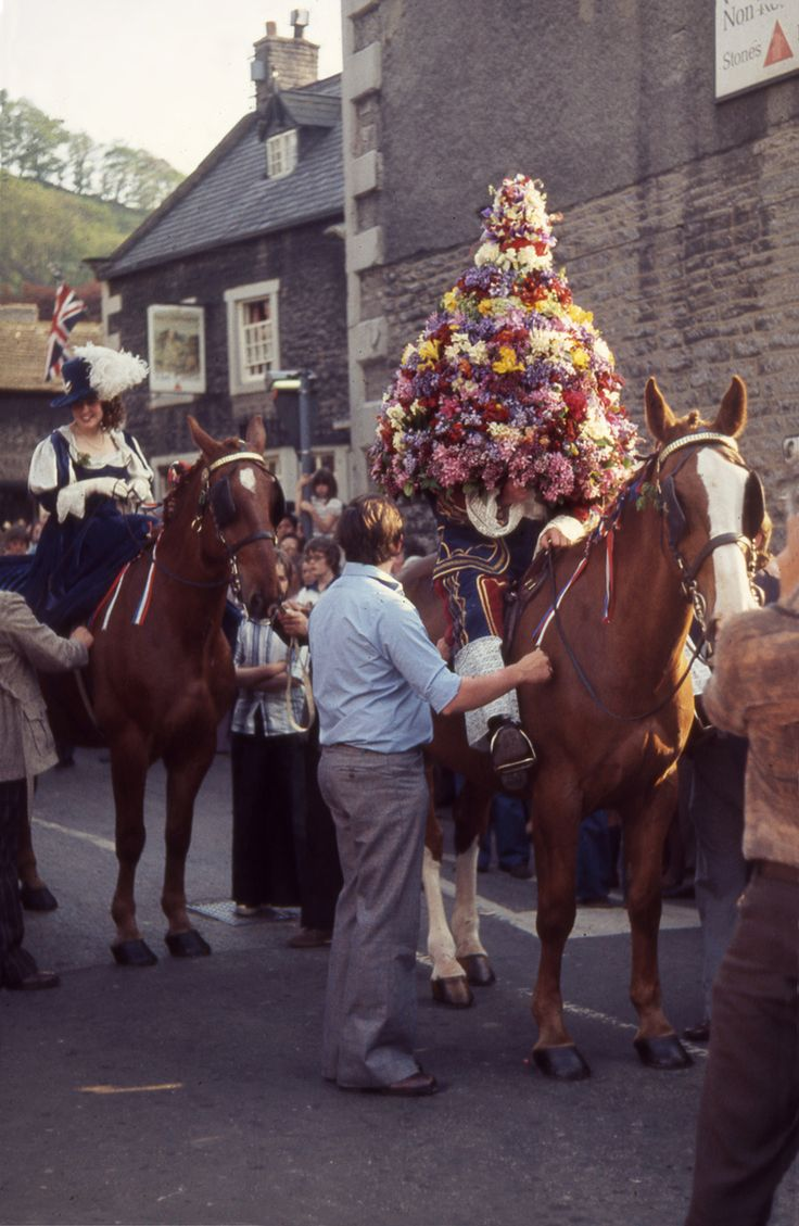 On Oak Apple Day  the Garland King rides through the streets of Castleton, Derbyshire, at the head of a procession, completely disguised in a garland of flowers, which is later affixed to a pinnacle on the parish church tower.  He is perhaps a kind of Jack in the Green and the custom may have transferred from May Day.