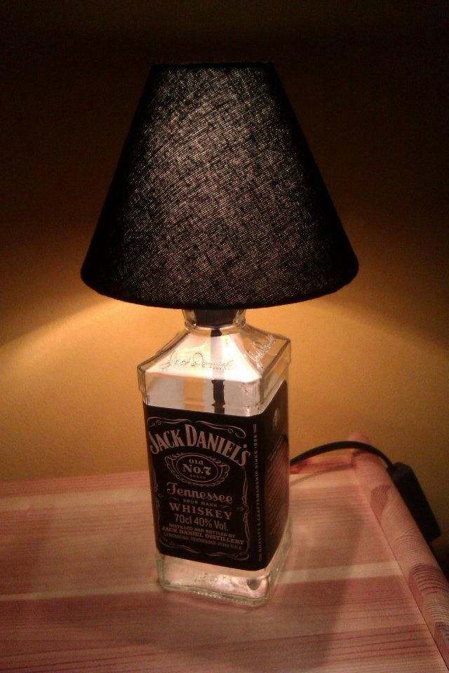Another use for an empty bottle... Turn it into a table lamp