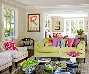 To inject some fun into your living room, start with the floor. Look for a boldly patterned area rug filled with candy shades like lemon, orange, bubblegum, grape, and blueberry. You can then pull these hues into throw pillows, artwork, and accessories. A heaping portion of pure marshmallow-cream white on the walls, the sofa, the fireplace surround, and the chairs will keep all the colors from running amok.