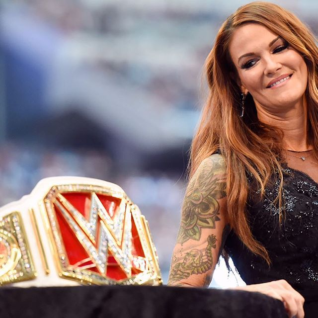 Lita and the new Women's Championship Belt- I basically was crying bc WrestleMania and there's a WOMEN'S championship, even though the ending of that match- FLAIR I CANT HATE YOU BUT SERIOUSLY?!