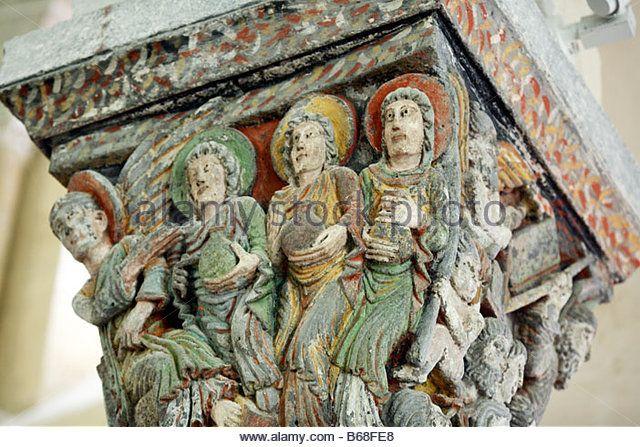 Sculpture on capital columns, Interior of Romanesque church (1080), Saint Nectaire, Auvergne, France - Stock Photo