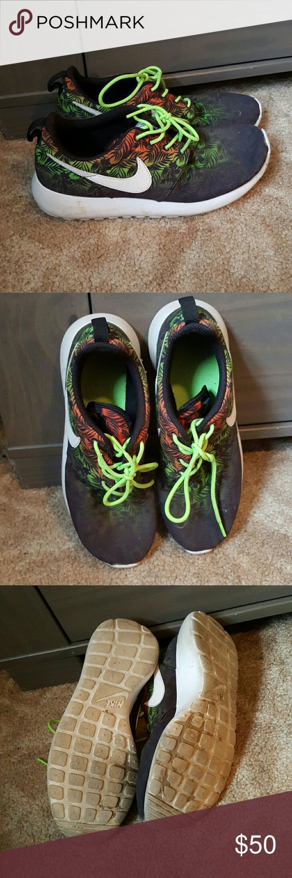 Jungle Print Nike Roshe Runs Black, Orange, Red, Yellow, and Green Ombre with tropical leaves. Size Youth 7 equivilant to a womens 8.5 gently used, nothing a toss in the washer cant clean up. Make me an offer I cant refuse!! Nike Shoes Athletic Shoes