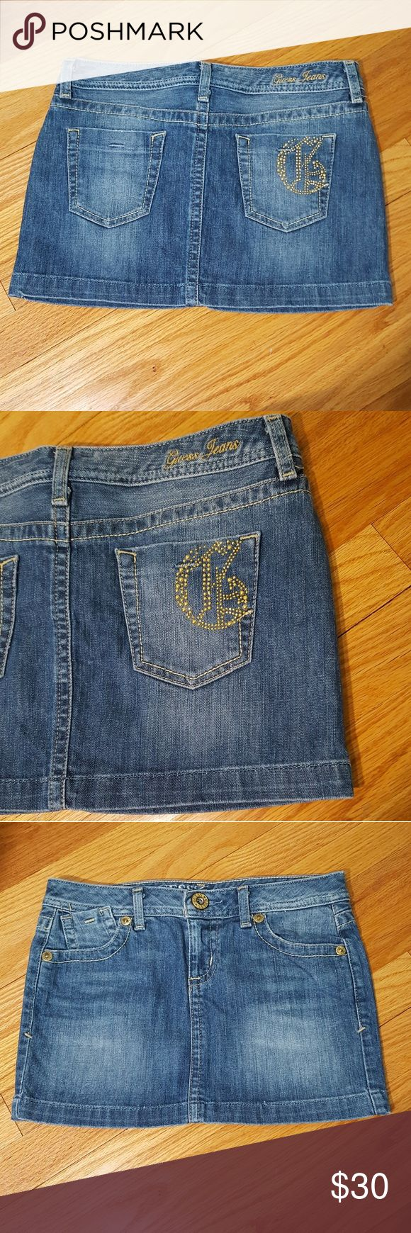 """Guess Jeans Light Denim Mini Skirt Gold Logo 26 Guess Jeans light denim mini skirt. Size 26. Excellent condition. Gorgeous gold studded Guess 'G' logo on back pocket. Yellow stitching throughout, large Guess button, sandblasted finish. Measures 28"""" waist, 11"""" length. 99% cotton, 1% lycra for stretch and comfort. This denim mini skirt will be your go-to this Summer! Guess Skirts Mini"""