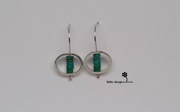 Silver earrings with turquoise gemstones.