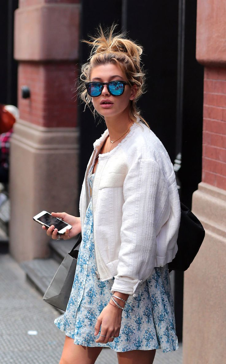 Breezy dress, white jacket, messy hair, and reflective sunnies.