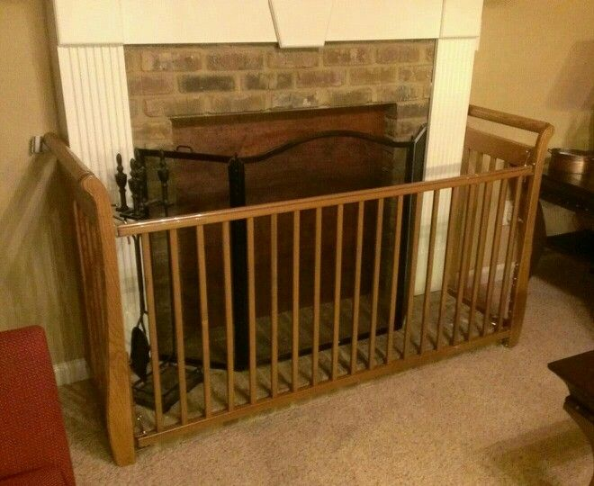Fireplace gate made from a recalled crib.