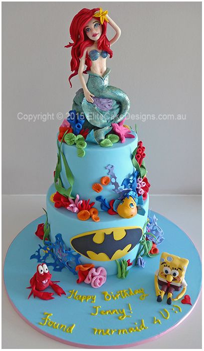A customised Ariel Mermaid girls birthday cake featuring finely detailed hand-sugarcrafted figurines of Ariel Mermaid, Sebastian, Flounder and SpongeBob! As per the customer's request we added the Batman logo